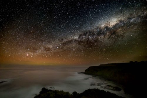 The Milky Way points down to an auroral glow over Bass Strait. Equatorial mount allowed a 2-minute exposure.